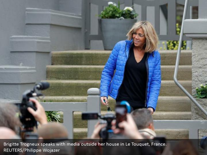 Brigitte Trogneux speaks with media outside her house in Le Touquet, France.  REUTERS/Philippe Wojazer