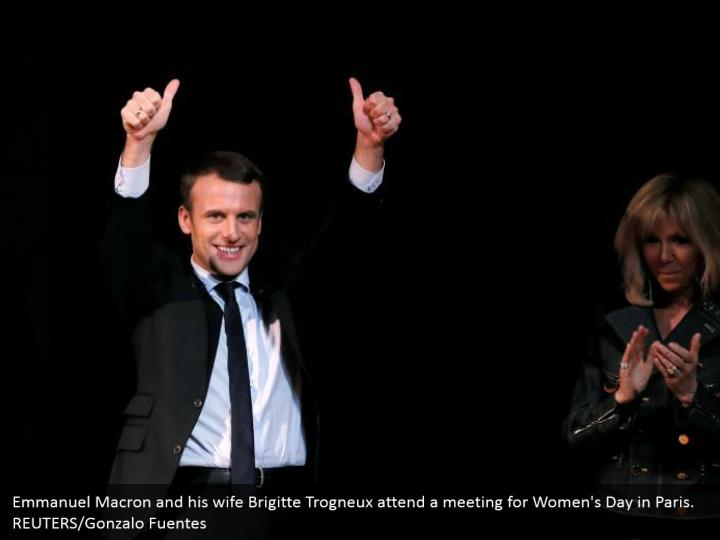 Emmanuel Macron and his wife Brigitte Trogneux attend a meeting for Women's Day in Paris. REUTERS/Gonzalo Fuentes