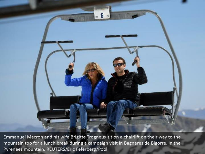 Emmanuel Macron and his wife Brigitte Trogneux sit on a chairlift on their way to the mountain top for a lunch break during a campaign visit in Bagneres de Bigorre, in the Pyrenees mountain. REUTERS/Eric Feferberg/Pool