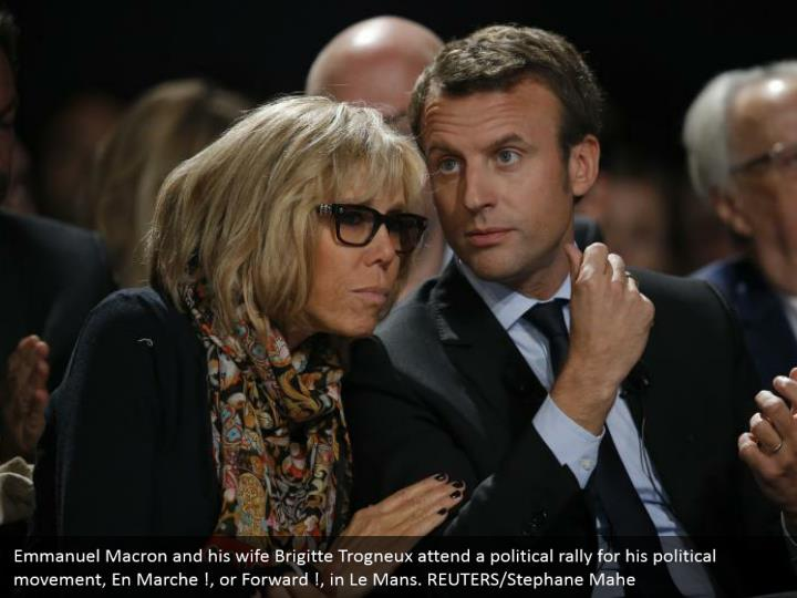 Emmanuel Macron and his wife Brigitte Trogneux attend a political rally for his political movement, En Marche !, or Forward !, in Le Mans. REUTERS/Stephane Mahe