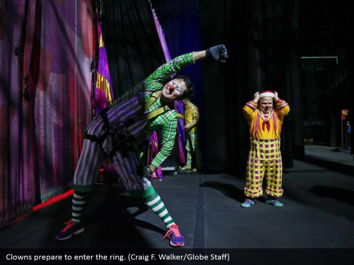 Clowns prepare to enter the ring. (Craig F. Walker/Globe Staff)