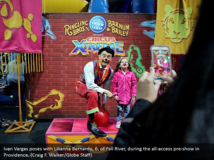 Ivan Vargas poses with Lilianna Bernardo, 6, of Fall River, during the all-access pre-show in Providence. (Craig F. Walker/Globe Staff)