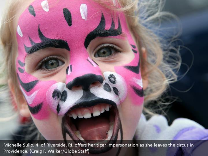 Michelle Sullo, 4, of Riverside, RI, offers her tiger impersonation as she leaves the circus in Providence. (Craig F. Walker/Globe Staff)