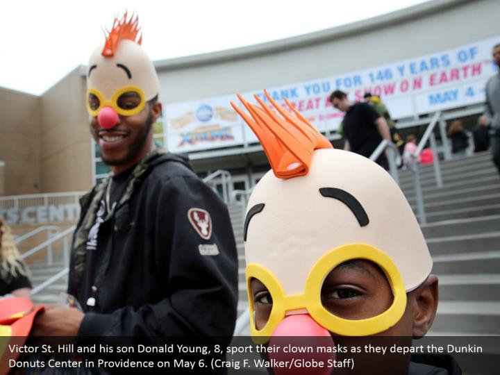 Victor St. Hill and his son Donald Young, 8, sport their clown masks as they depart the Dunkin Donuts Center in Providence on May 6. (Craig F. Walker/Globe Staff)