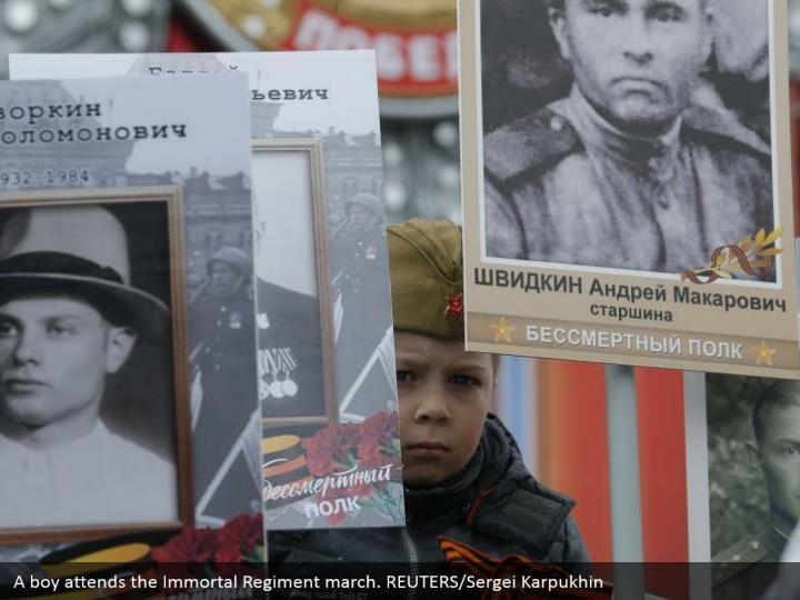 A boy attends the Immortal Regiment march. REUTERS/Sergei Karpukhin