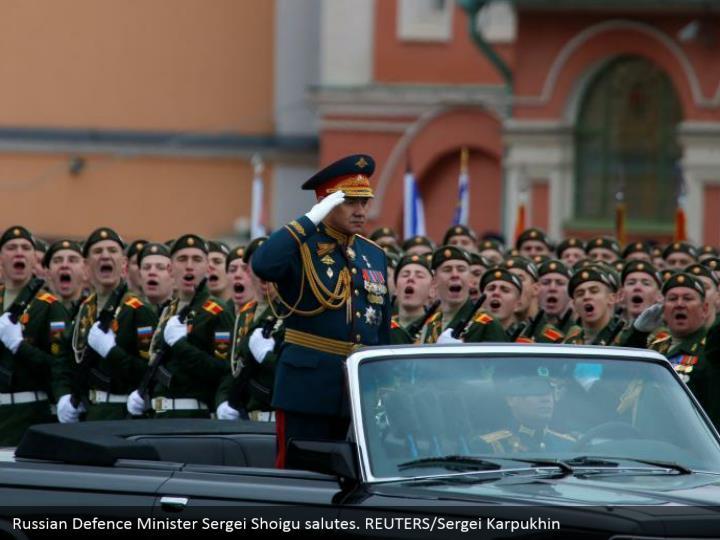 Russian Defence Minister Sergei Shoigu salutes. REUTERS/Sergei Karpukhin