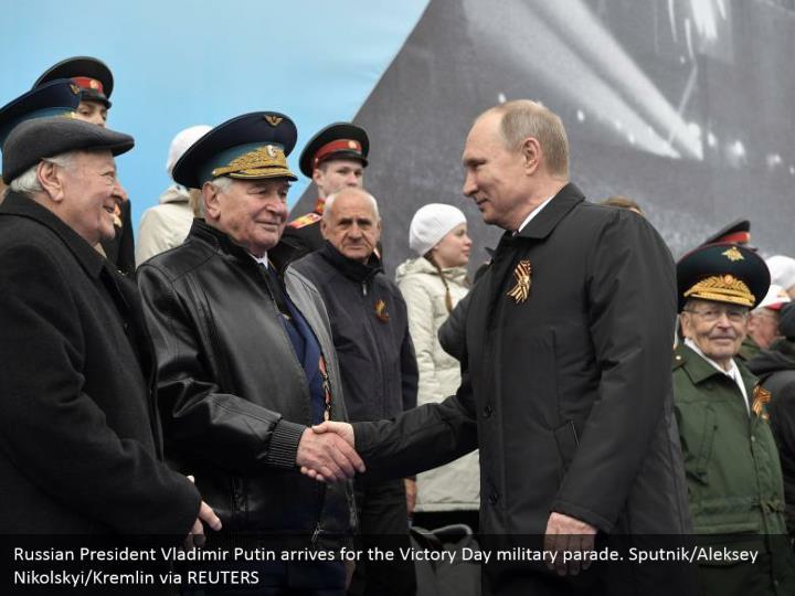 Russian President Vladimir Putin arrives for the Victory Day military parade. Sputnik/Aleksey Nikolskyi/Kremlin via REUTERS