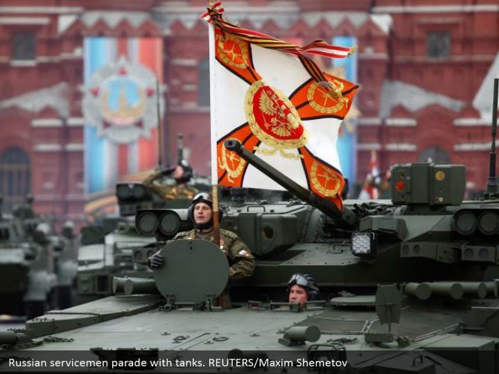 Russian servicemen parade with tanks. REUTERS/Maxim Shemetov