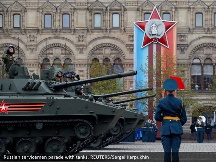 Russian servicemen parade with tanks. REUTERS/Sergei Karpukhin