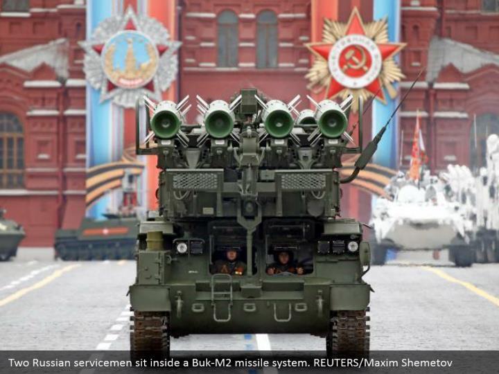 Two Russian servicemen sit inside a Buk-M2 missile system. REUTERS/Maxim Shemetov