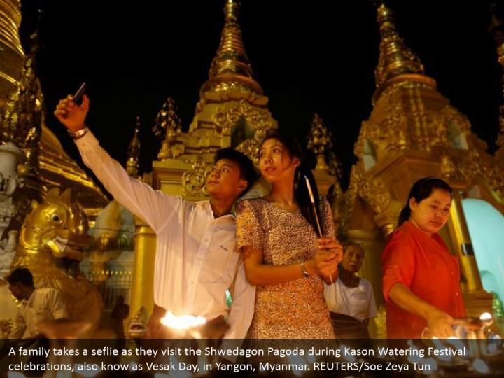 A family takes a seflie as they visit the Shwedagon Pagoda during Kason Watering Festival celebrations, also know as Vesak Day, in Yangon, Myanmar. REUTERS/Soe Zeya Tun
