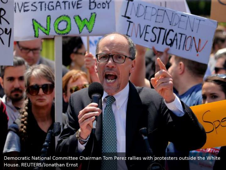 Democratic National Committee Chairman Tom Perez rallies with protesters outside the White House. REUTERS/Jonathan Ernst