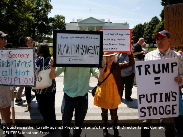 Protesters gather to rally against President Trump's firing of FBI Director James Comey.   REUTERS/Jonathan Ernst
