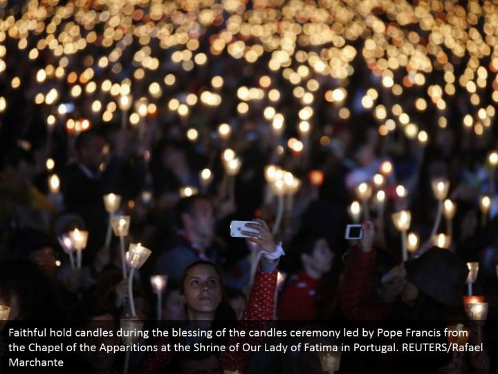 Faithful hold candles during the blessing of the candles ceremony led by Pope Francis from the Chapel of the Apparitions at the Shrine of Our Lady of Fatima in Portugal. REUTERS/Rafael Marchante