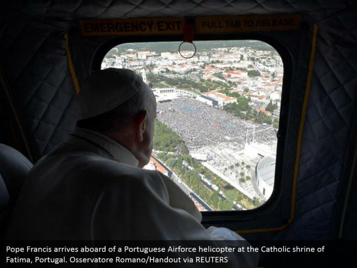 Pope Francis arrives aboard of a Portuguese Airforce helicopter at the Catholic shrine of Fatima, Portugal. Osservatore Romano/Handout via REUTERS