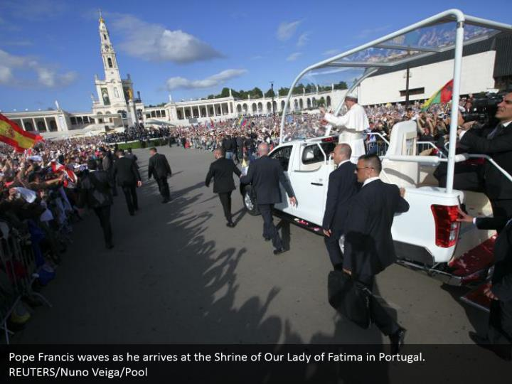 Pope Francis waves as he arrives at the Shrine of Our Lady of Fatima in Portugal. REUTERS/Nuno Veiga/Pool
