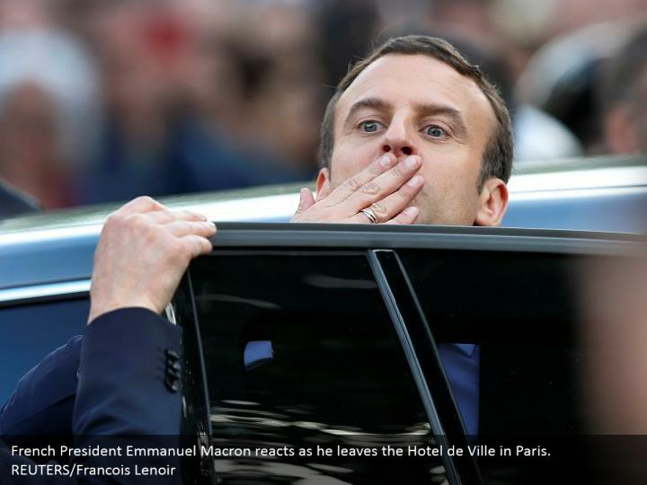 French President Emmanuel Macron reacts as he leaves the Hotel de Ville in Paris. REUTERS/Francois Lenoir