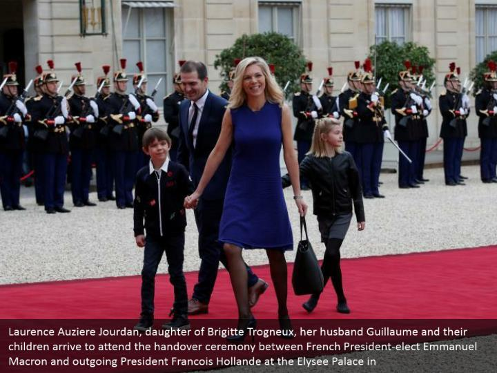 Laurence Auziere Jourdan, daughter of Brigitte Trogneux, her husband Guillaume and their children arrive to attend the handover ceremony between French President-elect Emmanuel Macron and outgoing President Francois Hollande at the Elysee Palace in