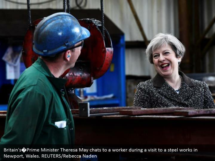 Britain's�Prime Minister Theresa May chats to a worker during a visit to a steel works in Newport, Wales. REUTERS/Rebecca Naden