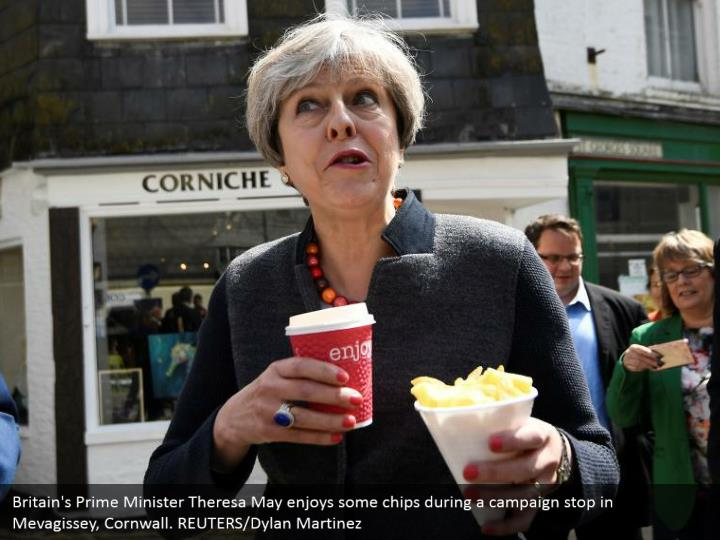 Britain's Prime Minister Theresa May enjoys some chips during a campaign stop in Mevagissey, Cornwall. REUTERS/Dylan Martinez