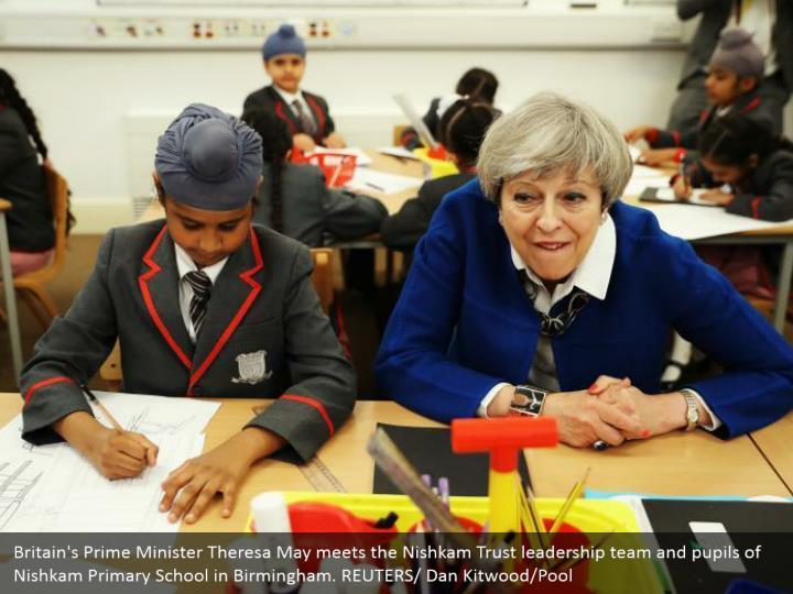 Britain's Prime Minister Theresa May meets the Nishkam Trust leadership team and pupils of Nishkam Primary School in Birmingham. REUTERS/ Dan Kitwood/Pool