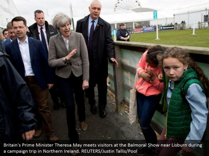 Britain's Prime Minister Theresa May meets visitors at the Balmoral Show near Lisburn during a campaign trip in Northern Ireland. REUTERS/Justin Tallis/Pool