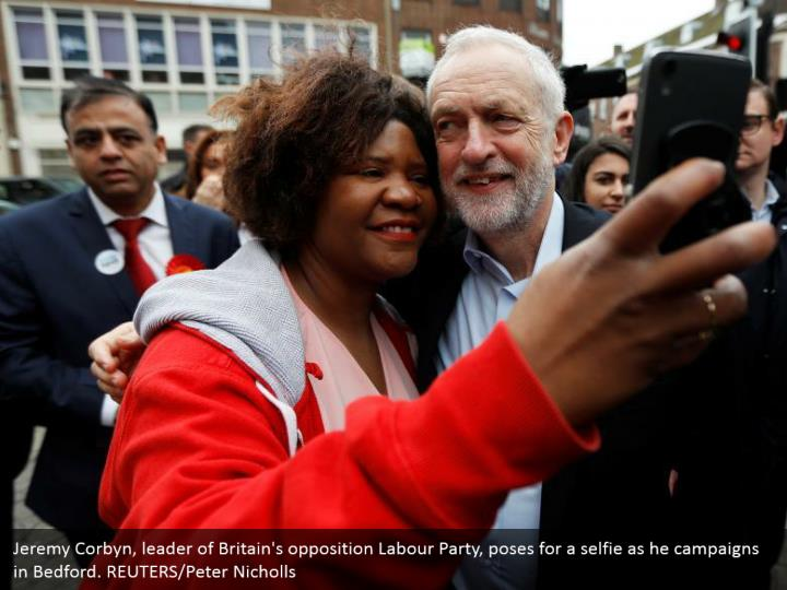Jeremy Corbyn, leader of Britain's opposition Labour Party, poses for a selfie as he campaigns in Bedford. REUTERS/Peter Nicholls