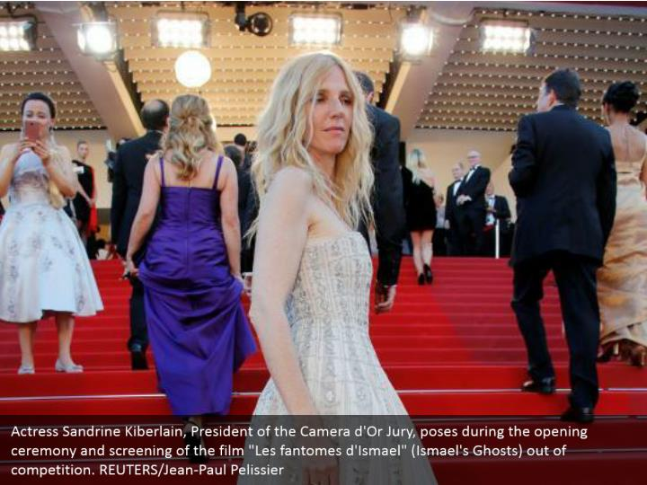 "Actress Sandrine Kiberlain, President of the Camera d'Or Jury, poses during the opening ceremony and screening of the film ""Les fantomes d'Ismael"" (Ismael's Ghosts) out of competition. REUTERS/Jean-Paul Pelissier"