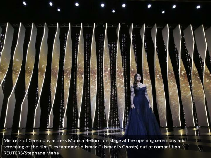 "Mistress of Ceremony actress Monica Bellucci on stage at the opening ceremony and screening of the film ""Les fantomes d'Ismael"" (Ismael's Ghosts) out of competition. REUTERS/Stephane Mahe"