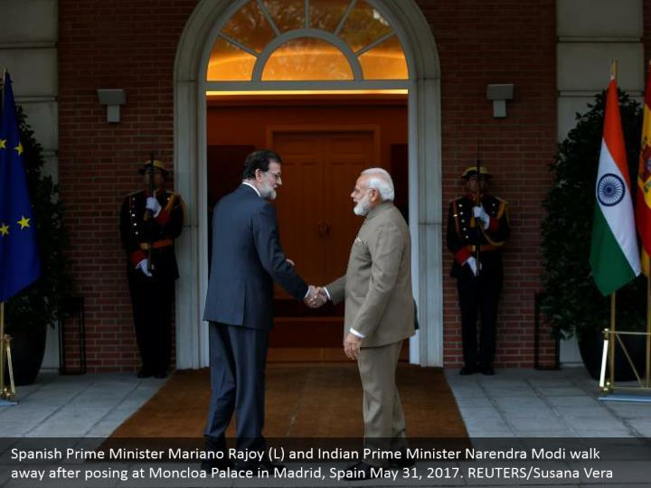 Spanish Prime Minister Mariano Rajoy (L) and Indian Prime Minister Narendra Modi walk away after posing at Moncloa Palace in Madrid, Spain May 31, 2017. REUTERS/Susana Vera