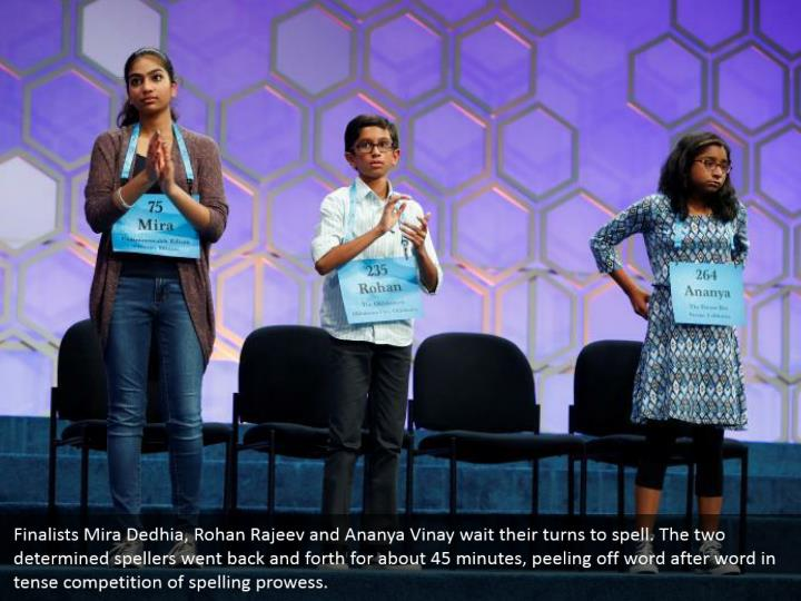 Finalists Mira Dedhia, Rohan Rajeev and Ananya Vinay wait their turns to spell. The two determined spellers went back and forth for about 45 minutes, peeling off word after word in tense competition of spelling prowess.
