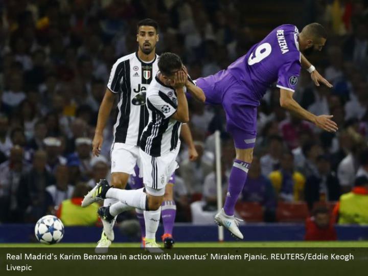 Real Madrid's Karim Benzema in action with Juventus' Miralem Pjanic. REUTERS/Eddie Keogh Livepic