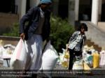 a man carries sacks of wheat flour he received