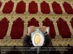 a palestinian man reads the koran in al aqsa 1