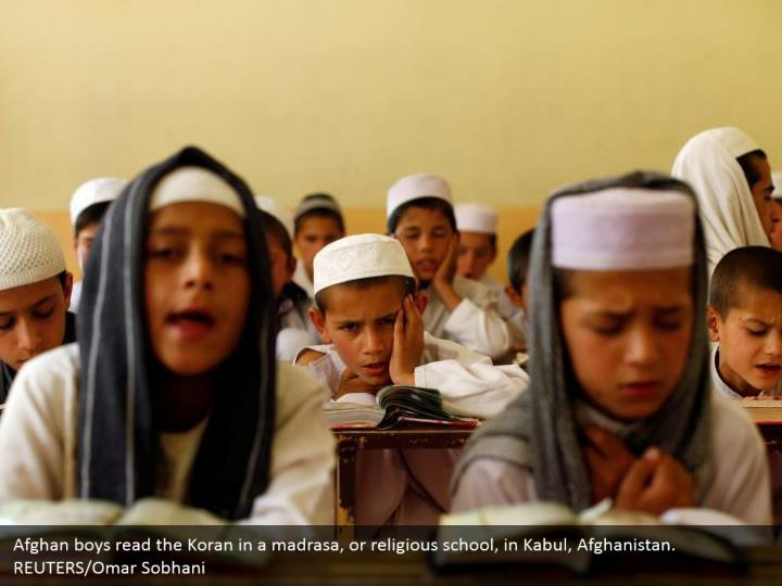 Afghan boys read the Koran in a madrasa, or religious school, in Kabul, Afghanistan. REUTERS/Omar Sobhani