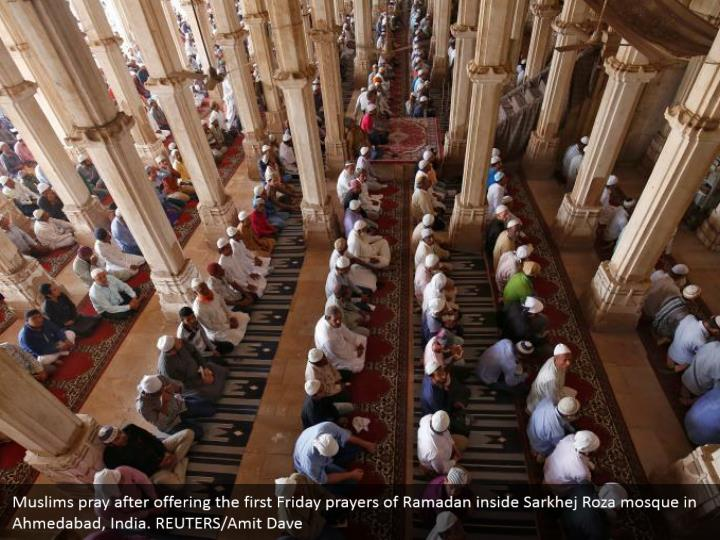 Muslims pray after offering the first Friday prayers of Ramadan inside Sarkhej Roza mosque in Ahmedabad, India. REUTERS/Amit Dave