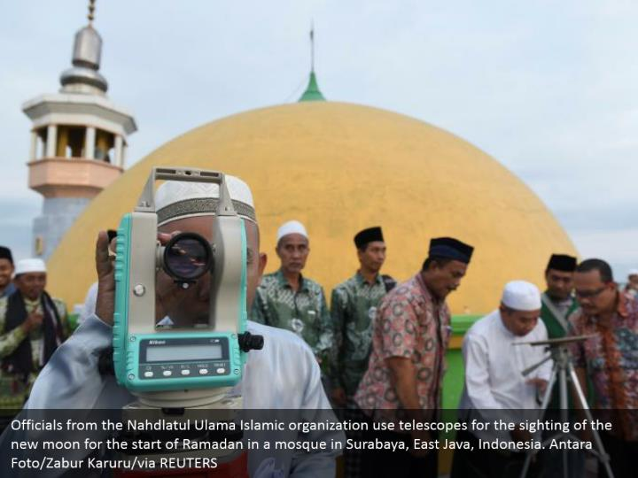 Officials from the Nahdlatul Ulama Islamic organization use telescopes for the sighting of the new moon for the start of Ramadan in a mosque in Surabaya, East Java, Indonesia. Antara Foto/Zabur Karuru/via REUTERS