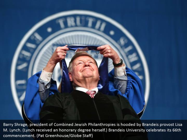 Barry Shrage, president of Combined Jewish Philanthropies is hooded by Brandeis provost Lisa M. Lynch. (Lynch received an honorary degree herself.) Brandeis University celebrates its 66th commencement. (Pat Greenhouse/Globe Staff)