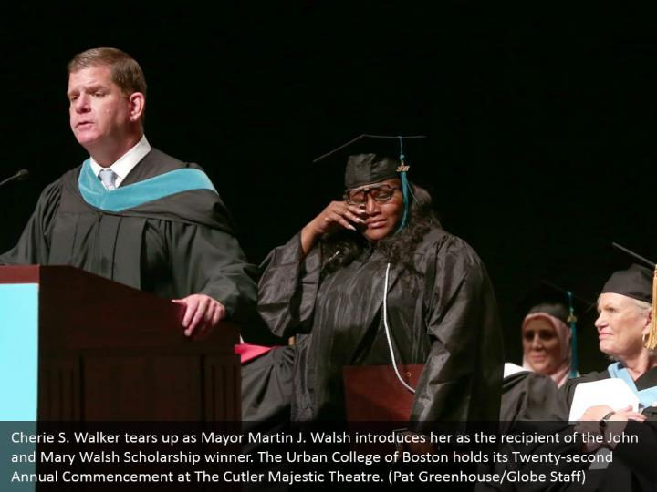Cherie S. Walker tears up as Mayor Martin J. Walsh introduces her as the recipient of the John and Mary Walsh Scholarship winner. The Urban College of Boston holds its Twenty-second Annual Commencement at The Cutler Majestic Theatre. (Pat Greenhouse/Globe Staff)