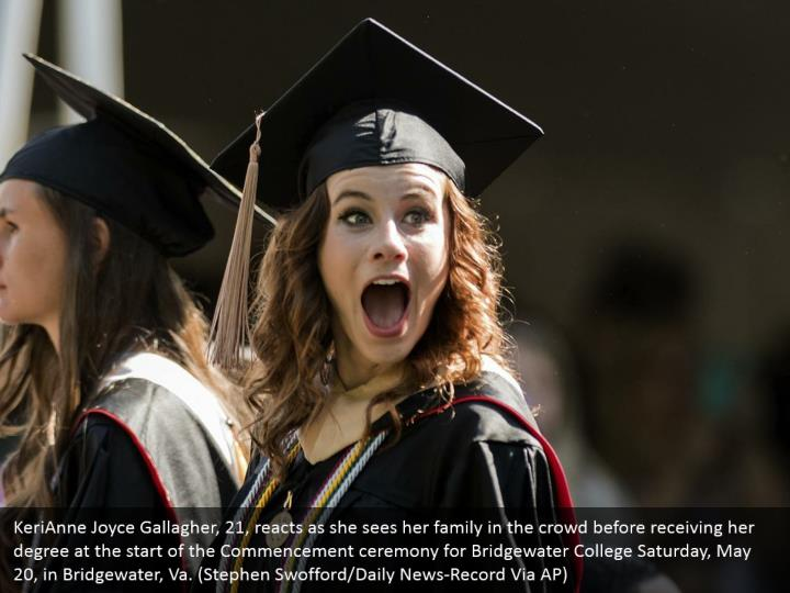 KeriAnne Joyce Gallagher, 21, reacts as she sees her family in the crowd before receiving her degree at the start of the Commencement ceremony for Bridgewater College Saturday, May 20, in Bridgewater, Va. (Stephen Swofford/Daily News-Record Via AP)