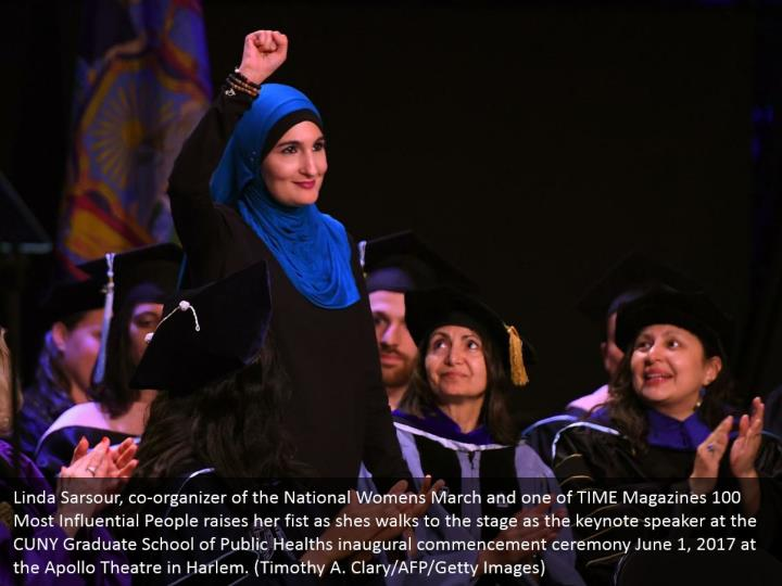 Linda Sarsour, co-organizer of the National Womens March and one of TIME Magazines 100 Most Influential People raises her fist as shes walks to the stage as the keynote speaker at the CUNY Graduate School of Public Healths inaugural commencement ceremony June 1, 2017 at the Apollo Theatre in Harlem. (Timothy A. Clary/AFP/Getty Images)