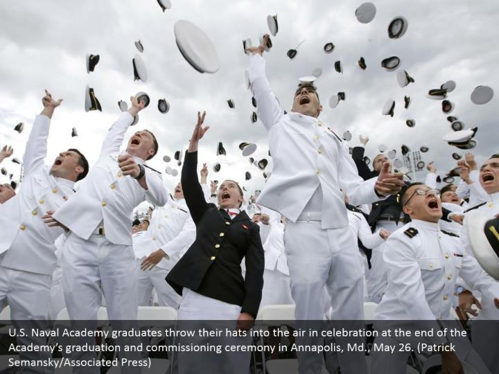 U.S. Naval Academy graduates throw their hats into the air in celebration at the end of the Academy's graduation and commissioning ceremony in Annapolis, Md., May 26. (Patrick Semansky/Associated Press)
