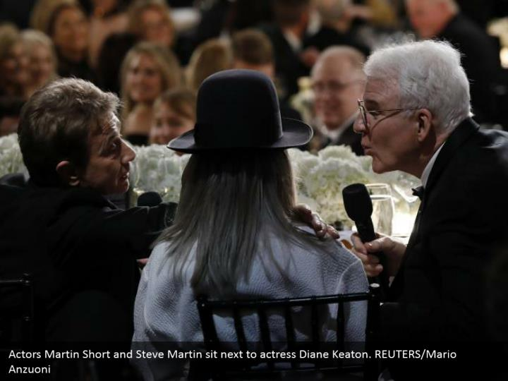 Actors Martin Short and Steve Martin sit next to actress Diane Keaton. REUTERS/Mario Anzuoni