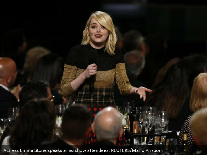Actress Emma Stone speaks amid show attendees. REUTERS/Mario Anzuoni
