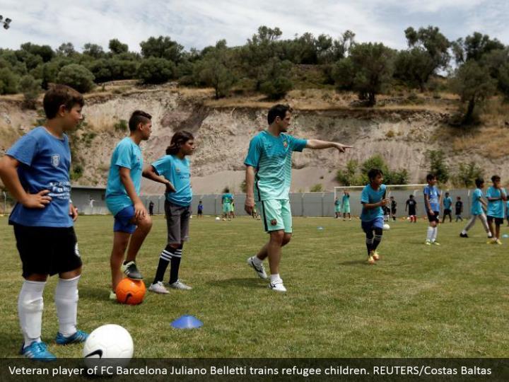 Veteran player of FC Barcelona Juliano Belletti trains refugee children. REUTERS/Costas Baltas