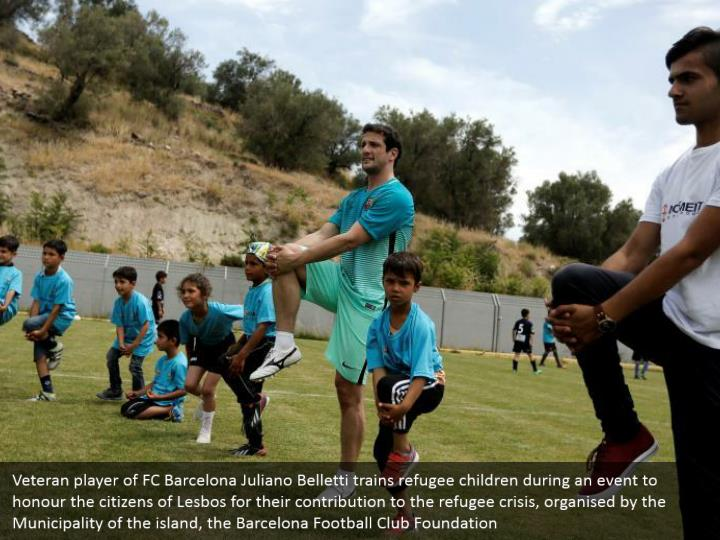 Veteran player of FC Barcelona Juliano Belletti trains refugee children during an event to honour the citizens of Lesbos for their contribution to the refugee crisis, organised by the Municipality of the island, the Barcelona Football Club Foundation