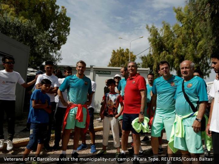 Veterans of FC Barcelona visit the municipality-run camp of Kara Tepe. REUTERS/Costas Baltas