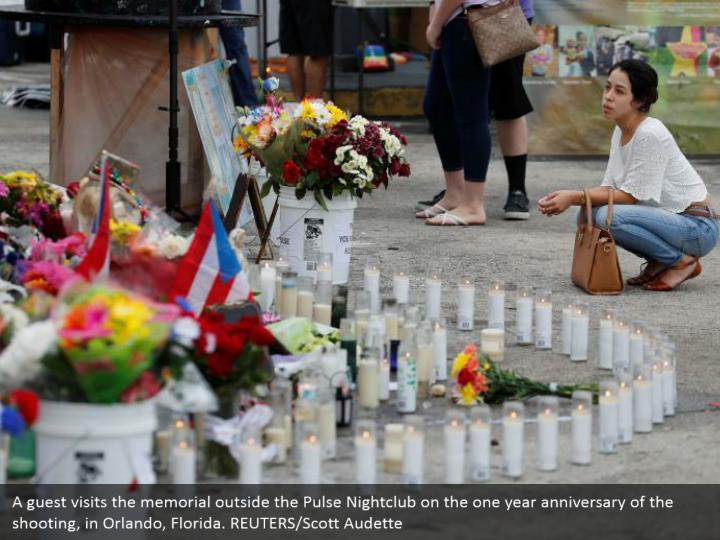 A guest visits the memorial outside the Pulse Nightclub on the one year anniversary of the shooting, in Orlando, Florida. REUTERS/Scott Audette