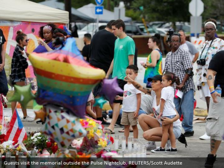 Guests visit the memorial outside the Pulse Nightclub. REUTERS/Scott Audette