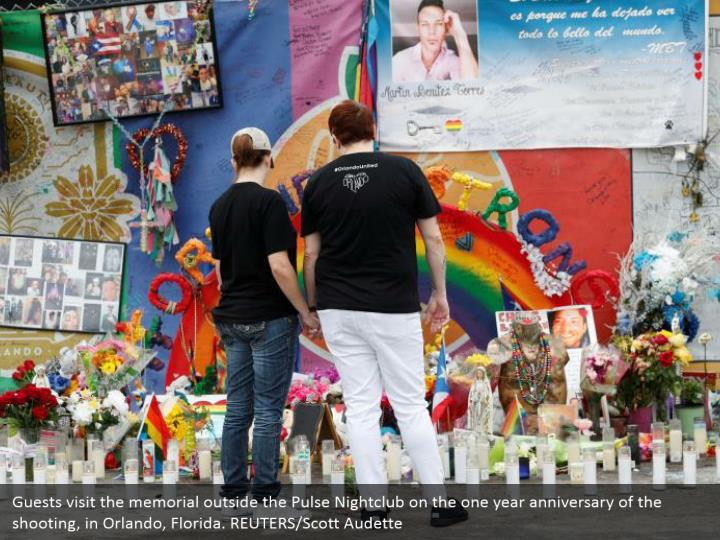 Guests visit the memorial outside the Pulse Nightclub on the one year anniversary of the shooting, in Orlando, Florida. REUTERS/Scott Audette